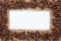 Frame Of Burlap And Coffee Beans Lying On A White Background Stock Photography - 46018292