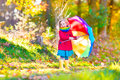 Little Girl In An Autumn Park Royalty Free Stock Photo - 46027255