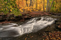 Waterfall In Autumn Stock Images - 46028484