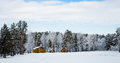 Wooden Houses In A Nature Area Covered With Snow. Stock Photography - 46033902