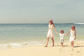 Happy Kids Playing On Beach Stock Images - 46035004