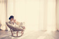 Woman Relaxing In Chair Royalty Free Stock Photo - 46039075