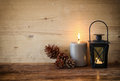Vintage Lantern With Burning Candle And Pine Cones On Wooden Table. Filtered Image Stock Photos - 46051943