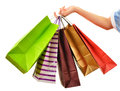 Female Hand Holding Paper Shopping Bags Isolated On White Royalty Free Stock Images - 46063079