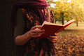 Young Woman Reading In The Park Stock Images - 46067514