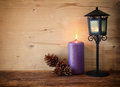 Vintage Lantern With Burning Candle And Pine Cones On Wooden Table. Filtered Image Stock Image - 46076331
