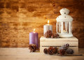 Vintage Lantern With Burning Candle And Pine Cones On Wooden Table. Filtered Image Royalty Free Stock Photos - 46076398