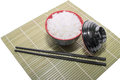Red Bowl Of Rice With Wooden Chopsticks And A Wood Place Mat Stock Image - 46097881