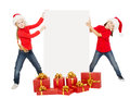 Happy Christmas Kids Holding Banner. Santa Helpers With Poster Stock Photo - 46108260
