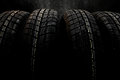 Dark Background With Winter Tires Royalty Free Stock Image - 46123166