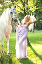 Laughing Lady Walking With Horse Royalty Free Stock Photo - 46141735