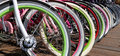 Row Multicolored Bicycle Wheels Closeup Stock Image - 46146421