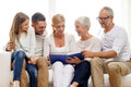 Happy Family With Book Or Photo Album At Home Royalty Free Stock Photo - 46149685