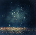Glitter Vintage Lights Background. Gold, Silver, Blue And Black. De-focused. Royalty Free Stock Photo - 46154645