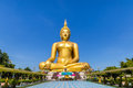 Biggest Golden Buddha Statue On Blue Sky Background Stock Photography - 46167532