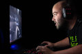Gamer Playing A First Person Shooter On High End Pc. Stock Image - 46182131
