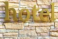 Hotel Sign On Stone Tiled Wall Royalty Free Stock Photography - 46197527