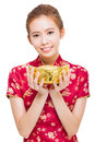 Happy Young Woman Showing  Gold For Chinese New Year Royalty Free Stock Images - 46227339