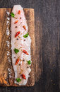 Raw Fish Fillet With Herbs And Spices On Dark Cutting Board Stock Photography - 46232132