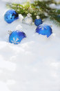Decorative Christmas Balls On The Snow And Brunch Of Christmas Tree Outdoor Stock Photography - 46243782