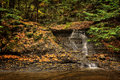 Waterfall In Autumn Stock Images - 46251794