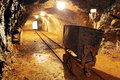 Underground Train Carts In Gold, Silver Mine Royalty Free Stock Photos - 46253568