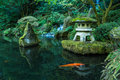 A Lantern And Waterfall In The Portland Japanese Garden Royalty Free Stock Images - 46270699