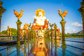 Gold Columns Leading To The Statue On Samui Stock Images - 46288014