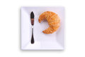 Fresh Croissant And A Knife On A White Plate Stock Photos - 46307343