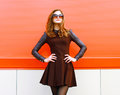 Pretty Woman In Black Dress And Sunglasses Posing Outdoors Stock Photography - 46315992