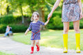Mother And Little Adorable Child Girl In Rubber Boots Having Fun Stock Images - 46329714