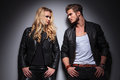 Hot Fashion Couple Leaning On A Grey Wall Royalty Free Stock Photos - 46332318