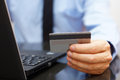 Businessman Is Using Credit Card For On Line Payment On Laptop Stock Image - 46337311