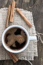 Cup Of Coffee With Cinnamon Sticks Stock Photo - 46341210