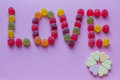 Word Love Spelled With Candy Stock Photography - 46342262