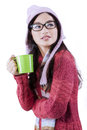 Pretty Girl Drinking Hot Tea In Studio Royalty Free Stock Photos - 46345168