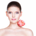 Portrait Of Pretty Face Of Beautiful Woman With A Pink Rose. Royalty Free Stock Image - 46346146