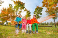 Group Of Happy Children Sitting On Hammock In Park Royalty Free Stock Photography - 46352597