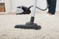 Low Section Of Woman Vacuuming Floor Stock Image - 46360061