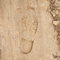 Shoe Step Left In The Sand Stock Photos - 46372643
