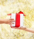 Close Up Of Child And Mother Hands With Gift Box Stock Photography - 46396792