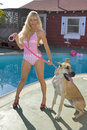 Woman In A Bikini With Dog Stock Images - 4643744
