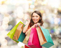 Smiling Woman With Colorful Shopping Bags Stock Photo - 46401690