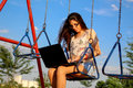 Woman On Swing With Notebook Stock Photography - 46401762