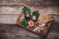 Rustic Style Cut Figs With Knife On Chopping Board And Wooden Ta Royalty Free Stock Images - 46426059