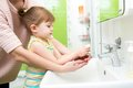 Child Girl Washing Hands With Soap In Bathroom Royalty Free Stock Photos - 46432608