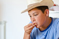 Teenager With Hat At Breakfast Stock Photos - 46447763