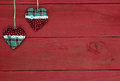 Country Fabric Christmas Hearts Hanging From Rope Against Antique Red Wood Background Royalty Free Stock Image - 46472636
