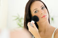 Beautiful Young Woman Applying Make-up With Cosmetics Brush Stock Images - 46484834