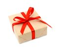 One Gift Christmas Box Wrapped With Kraft Paper And Red Bow Stock Image - 46486341